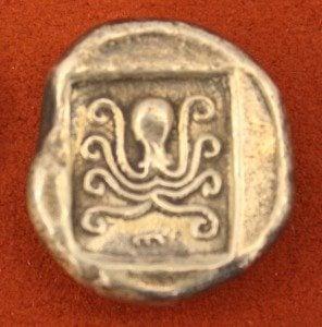 Silver tetradrachm from Eretria Euboea, c. 485 BCE. O: Cow, R: Octopus in incuse square.