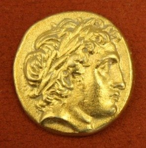 Macedonian Gold Stater, 359-336 BCE. O: Apollo, R: Charioteer.