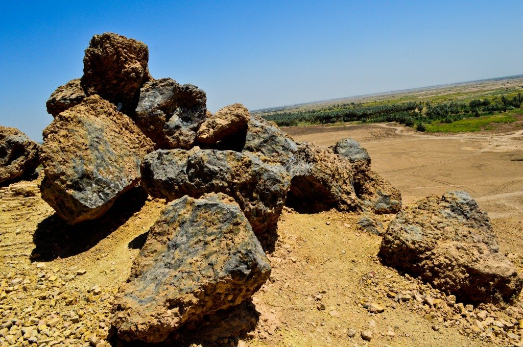These large rock-like conglomerates of mud-bricks, bitumen, and reed are likely the result of a hot fire and subsequent combustion. The ziggurat was destroyed deliberately by the Achaemenid king Xerxes in 484 BCE. Several of these rock-like structures can be found on the top surface of the ziggurat as well as the surrounding areas.