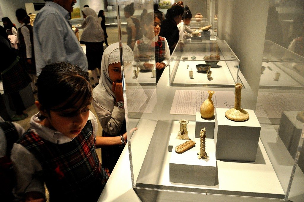 A group of primary school children are scrutinizing various artifacts. The girl close to me was looking at glass containers which date back from the Sasanian period (from 226 CE) to the early Islamic and Umayyad period (750 CE).