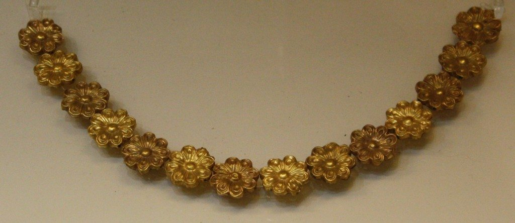 Strings of gold beads in the form of rosettes from Mycenae area (14th century BCE). Nafplio Archaeological Museum.