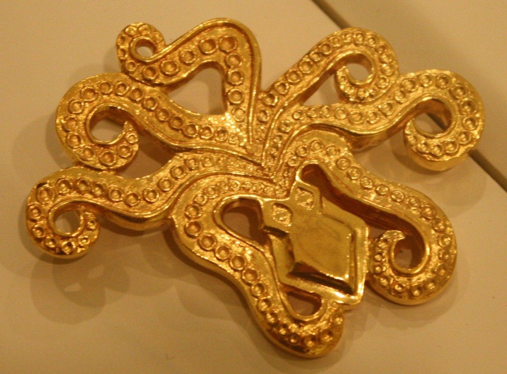 A gold Mycenaean brooch in the form of an octopus, Mycenae, mid 2nd millenium BCE. (Archaeological Museum, Mycenae)