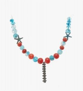 Necklace with cylinder amulet case 1700–1550 B.C. Silver, glazed crystal, carnelian, and faience *Harvard University—Boston Museum of Fine Arts Expedition *Photograph © Museum of Fine Arts, Boston