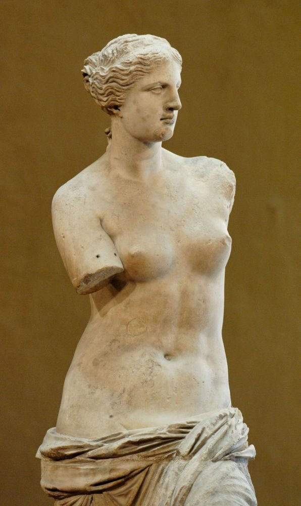 "So-called ""Venus de Milo"" (Aphrodite from Melos). Parian marble, ca. 130-100 BCE. Found in Melos in 1820 CE. On display at the Louvre, Paris. Photo by Jastrow, Public Domain."