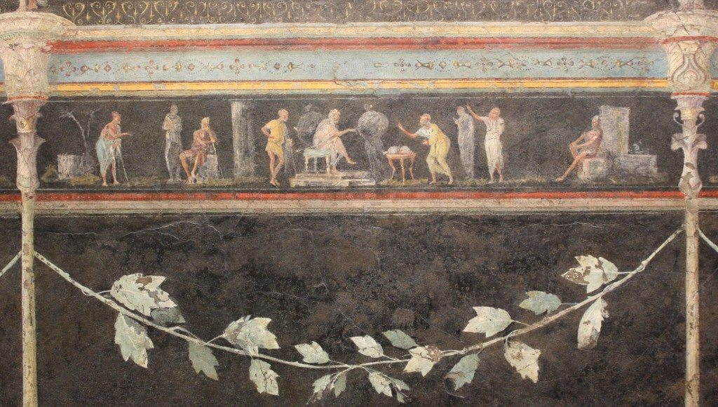 A detail of the 1st century BCE fresco which decorated the dining room (triclinium) of the Villa of the Farnesina in Rome. The long frieze depicts judicial scenes, perhaps famous cases and the events which led to the trial. Palazzo Massimo, Rome.