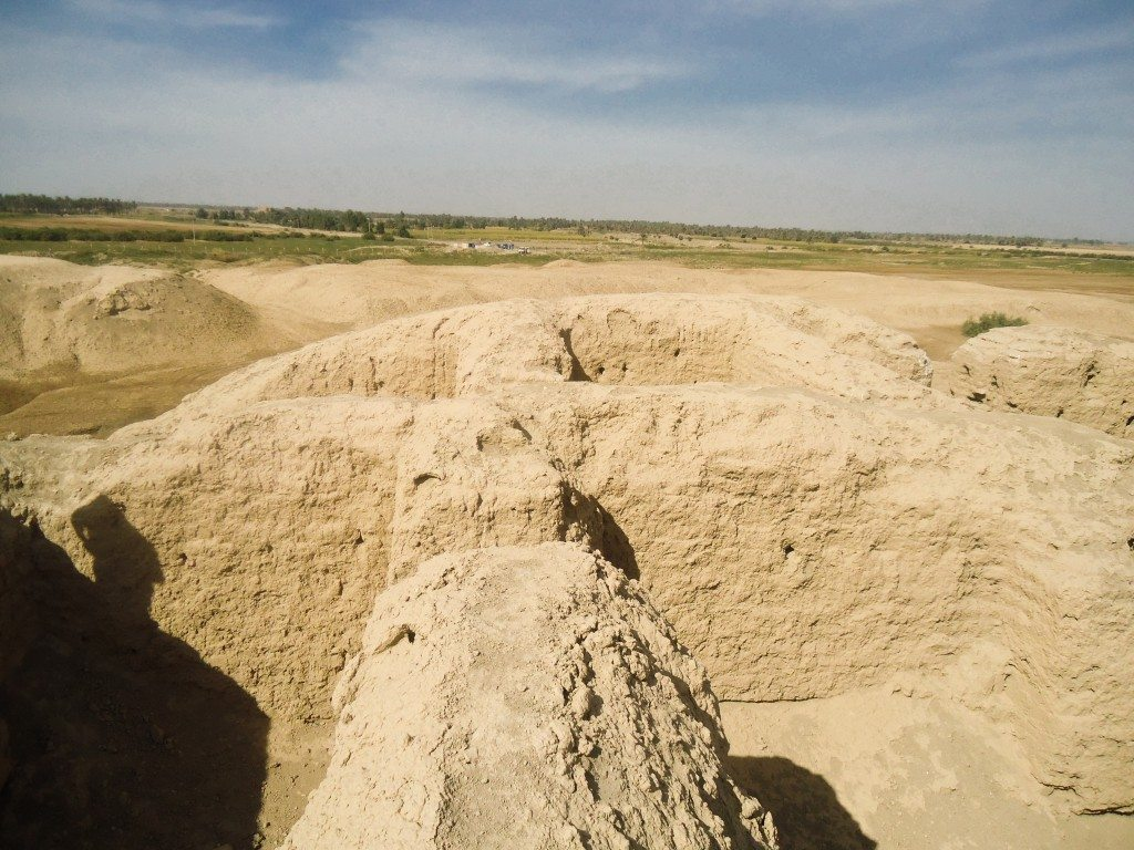 Note the room-like chambers within the mound. Some farms appear on the horizon.