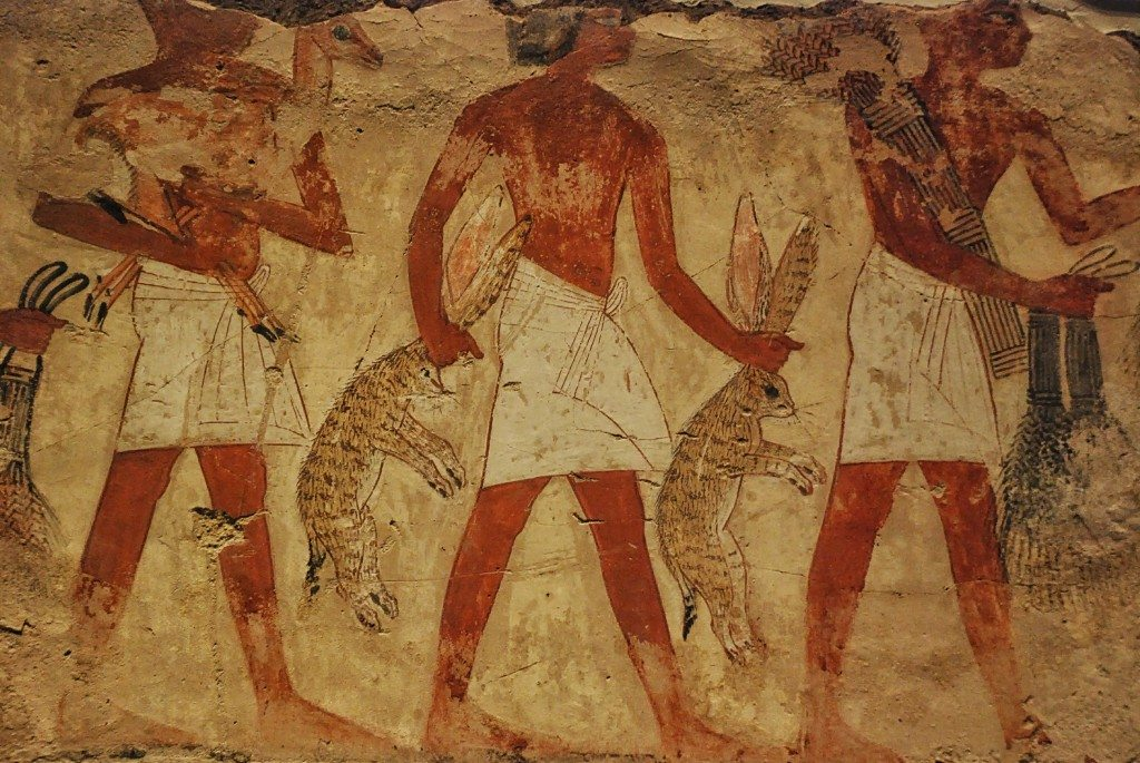 Servants carry hunted desert hares as offerings to Nebamun.