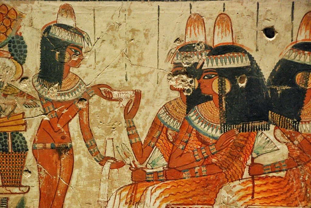 A naked lady brings offerings to Nebamun's wife.