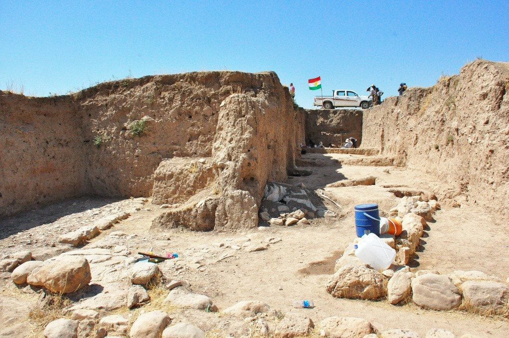 """The so-called """"Area 1,"""" which dates back to the early Bronze Age. These stone foundations and floors belongs to an Akkadian or post-Akkadian period building. A vaulted tomb had been covered with fragments of stones and earth, and behind it, we can see mud platforms."""