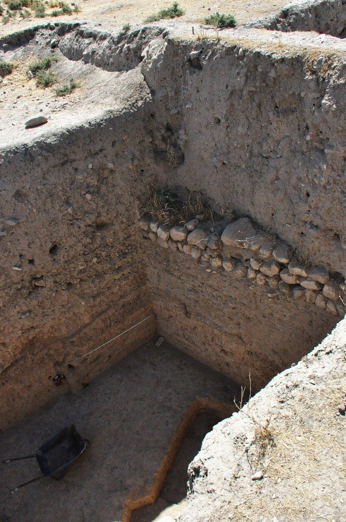 One of the excavated areas. Note how deep they have reached and the appearance of a foundation stone layer.