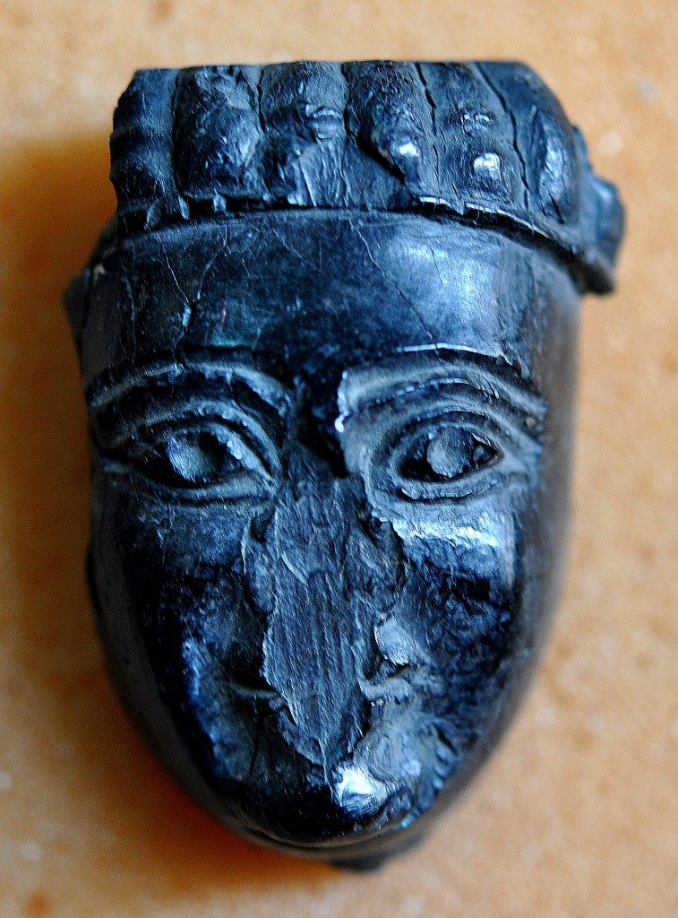 A burned ivory head of a man or woman. Neo-Assyrian period, 9th-7th centuries BCE. From Nimrud, Mesopotamia, Iraq. (The Sulaimaniya Museum, Iraq).