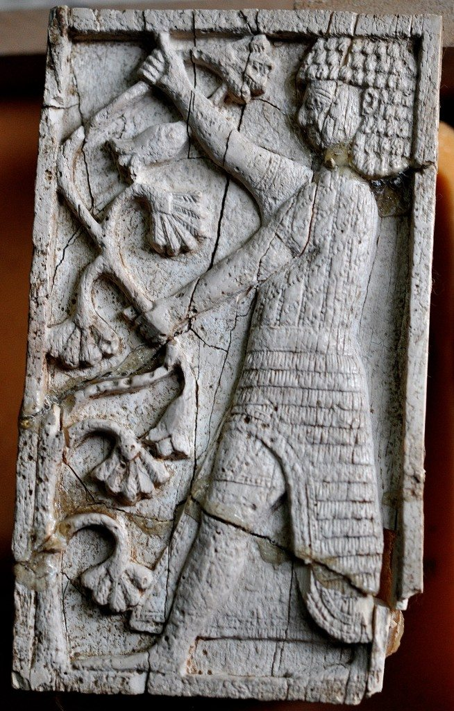 A standing man with an Egyptian appearance holds branches of a lotus tree. Neo-Assyrian period, 9th-7th centuries BCE. From Nimrud, Mesopotamia, Iraq. (The Sulaimaniya Museum, Iraq).