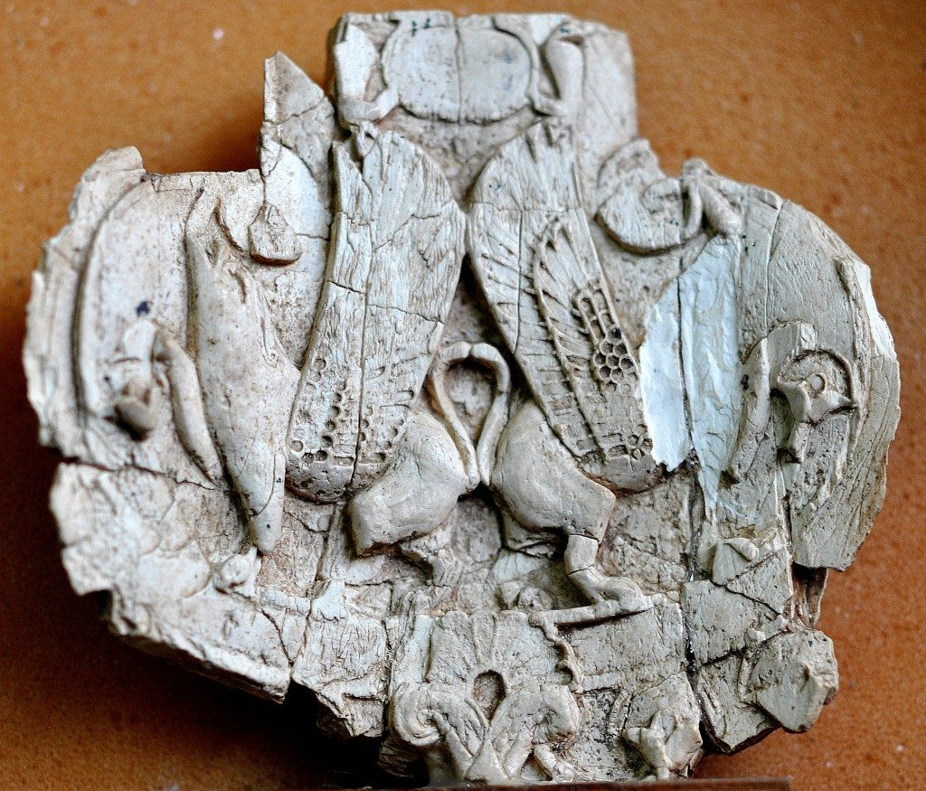 Partially damaged ivory plaque which depicts 2 winged 4-legged animals. The animals are striding, back to back. Neo-Assyrian period, 9th-7th centuries BCE. From Nimrud, Mesopotamia, Iraq. (The Sulaimaniya Museum, Iraq).