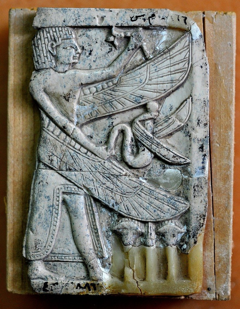 This carved ivory plaque depicts a standing man with an Egyptian hair style. The man has 2 wings and holds a snake. Neo-Assyrian period, 9th-7th centuries BCE. From Nimrud, Mesopotamia, Iraq. (The Sulaimaniya Museum, Iraq).