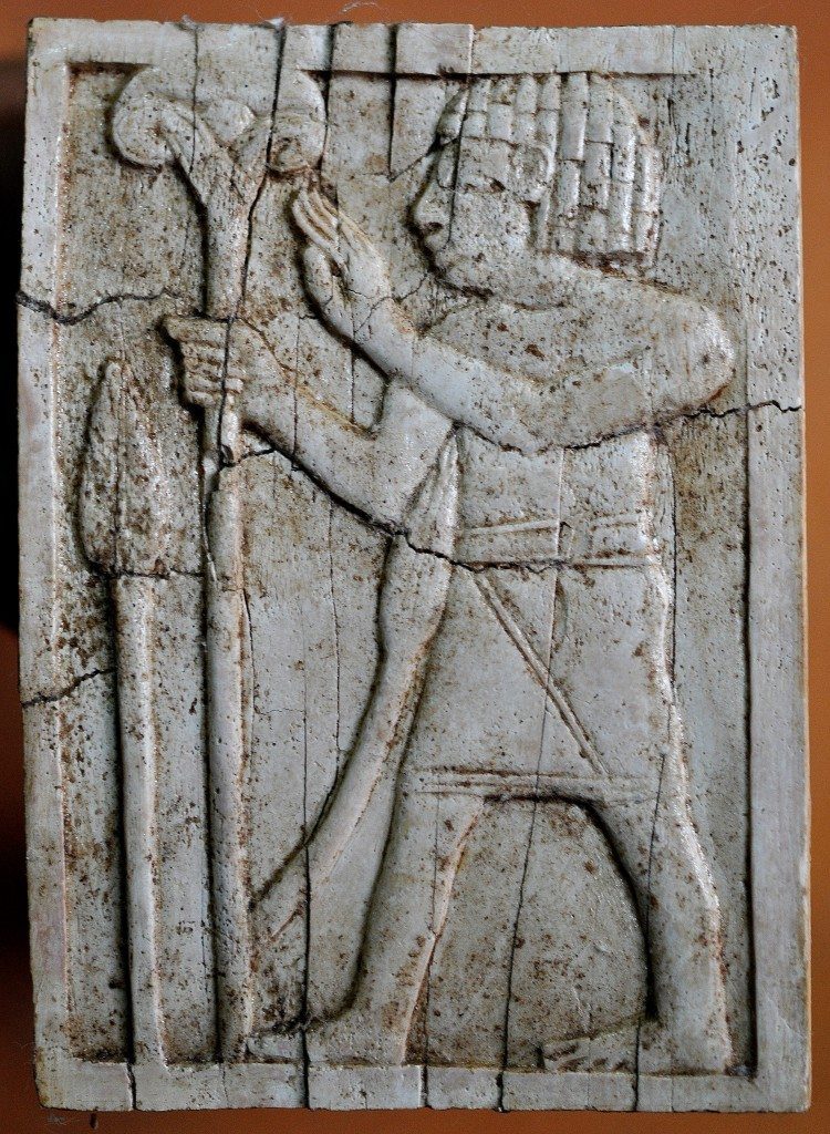 An Egyptian-looking man holds a lotus flower on a long stalk. Neo-Assyrian period, 9th-7th centuries BCE. From Nimrud, Mesopotamia, Iraq. (The Sulaimaniya Museum, Iraq).