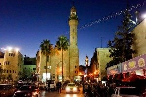 In Bethlehem, the Mosque of Omar with its towering minaret shares Manger Square with the Church of the Nativity. (photo: Rick Steves)
