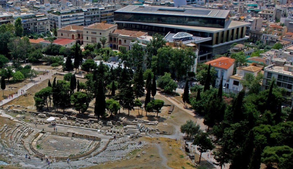 The New Acropolis Museum and the Theatre of Dionysus as viewed from the Acropolis. Author's own.