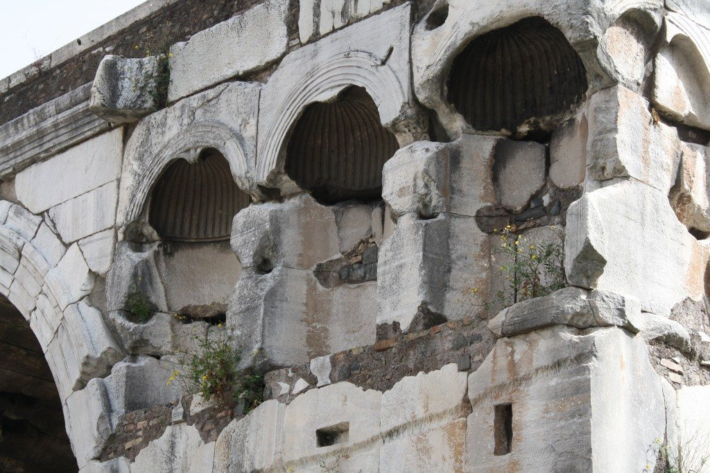 A detial of the niches of the Arch of Janus, Rome. They would have once had statues placed in them.