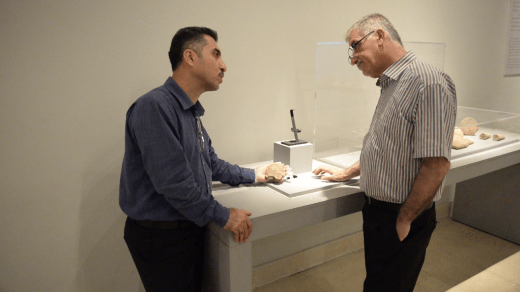 Mr. Hashim Hama Abdullah, director of the Sulaymaniayh Museum (left) and Mr. Kamal Rashid, director of the General Directorate of Antiquities of Sulaymaniayh (right) discuss the importance of the tablet and how it was found. The Sulaymaniayh Museum, Iraq. Photo © Osama S.M. Amin.