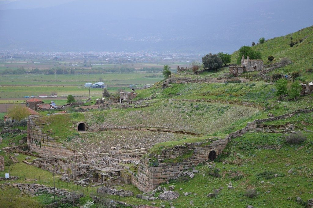 The Hellenistic theate of Alabanda, located on a natural south-facing hillside. The theatre could hold 6,000 spectators in its early phase. In the Imperial period, gladiator and animal combats were increasingly in demand, and a new design was created to fill these needs.