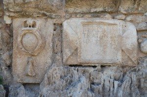 Inscription dedicated to Hadrian, from the High Level Aqueduct of Caesarea at Beit Hananya, with emblem depicting the 10th legion.
