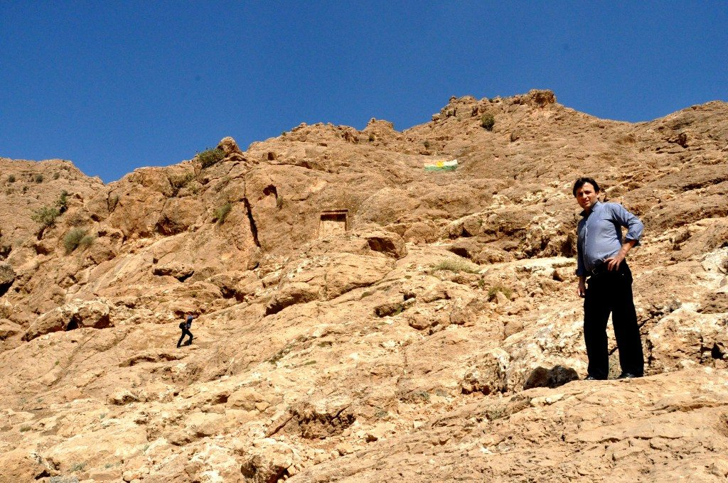 Approaching the relief. Dana Hiwa (left, my relative) and Mr. (right). Note the flag of Iraqi Kurdistan. Exclusive photo. ©Osama S. M. Amin.