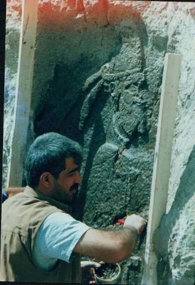 Making Merquli's replica on the original rock relief. August 2000. Photo courtesy Mr. Akam Omar.