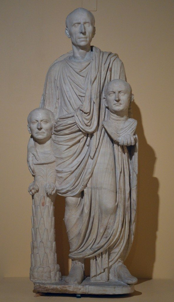 The so-called Togatus Barberini group, a funerary statue depicting a Roman senator holding the imagines (effigies) of deceased ancestors, late 1st century BC, head (not belonging) middle 1st century BC Centrale Montemartini, Rome museum. Photo © Carole Raddato.