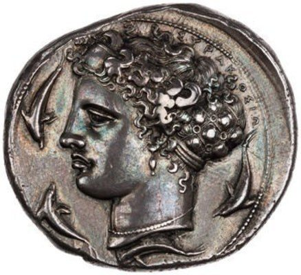 ​10 Drachm (decadrachm) with Arethusa from Syracuse, 405-400 BCE. The American Numismatic Society (1964.79.21). Arethusa's hair is gathered in an ampyx, a leather or metal band just above her forehead, which is connected to a large open-work hairnet filled with her long hair. This late 5th century BCE version of Arethusa shows richly textured, curly hair, with short loose ends projecting outward along the top of her head along with the inscription ΣΥΡΑΚΟΣΙΟ (Syracuse). The hairnet shows long locks of hair in each section, with surfaces now partly worn, separated by small discs decorating the interstices of the net. While the hairnet is intended to control Arethusa's hair, it more successfully brings attention to the coils escaping from it. Such an elaborate hair accessory, presumably made of metal, is related to the Hairnet with Medallion (no. 31), and both exemplify the luxurious nature of hair accessories in the Greek Classical and Hellenistic periods.