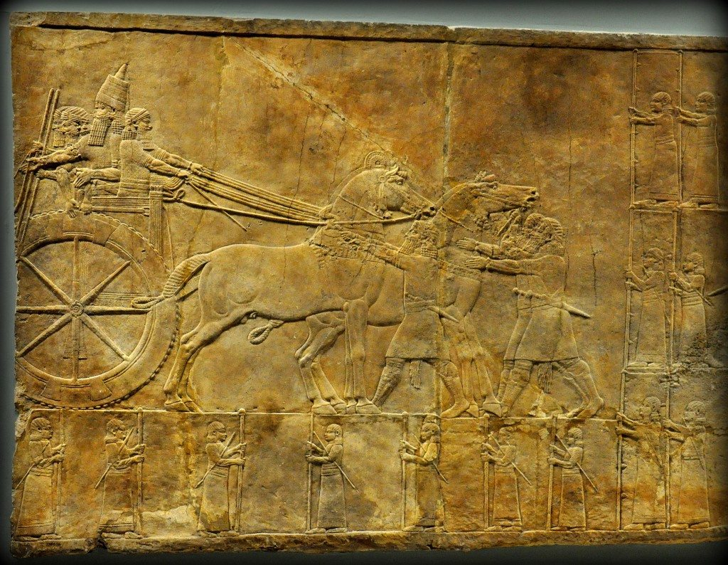 Assyrian Lion. In this alabaster bas-relief, the Assyrian king ashurbanipal stands in his royal chariot while his men do the necessary preparations before the hunt starts. He holds a long spear. From Room C of the North Palace, Nineveh (modern-day Kouyunjik, Mosul Governorate), Mesopotamia, Iraq. Circa 645-535 BCE. The British Museum, London. Photo©Osama S.M. Amin.