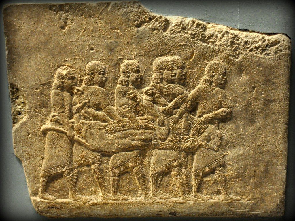 Alabaster bas-relief showing 6 men carrying a dead lion at the end of the hunt. From Room C of the North Palace, Nineveh (modern-day Kouyunjik, Mosul Governorate), Mesopotamia, Iraq. Circa 645-535 BCE. The British Museum, London. Photo©Osama S.M. Amin.