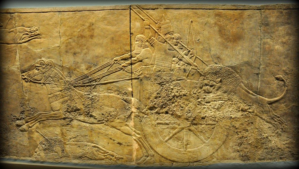 Alabaster bas-relief showing Ashurbanipal in his royal chariot hunting a lion. The lion has already hit by 2 arrows and he has leaped towards the rear part of the chariot. Two royal attendants, one holds a bow and the other one holds a spear, are trying to ward the lion of the king. The king holds a long spear with his 2 hands, thrusting forcefully upon the lion's head; the lion tries to turn his head away. From Room C of the North Palace, Nineveh (modern-day Kouyunjik, Mosul Governorate), Mesopotamia, Iraq. Circa 645-535 BCE. The British Museum, London. Photo©Osama S.M. Amin.