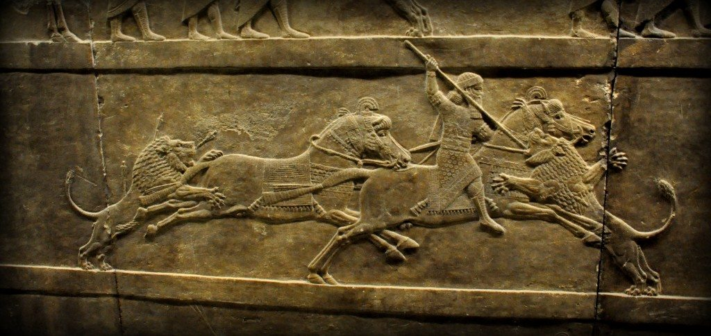 Alabaster bas-relief showing Ashurbanipal thrusting a spear onto a lion's head. This is one of the very anxious moments which was carefully conveyed to us by the artist! The register is part of 3 relatively small-scale registers. The king's spare horse was attacked by a wounded lion that has been left for dead. The king himself is busy with another furiously attacking lion. The king's attendants (not shown in this picture) lagged behind and galloped desperately to rescue their king (from the left side of the panel). The sculptor used empty spaces (before and behind the king) to dramatic effect, one of the features that sets Ashurbanipal's hunt scenes apart from the general run of Assyrian sculpture.