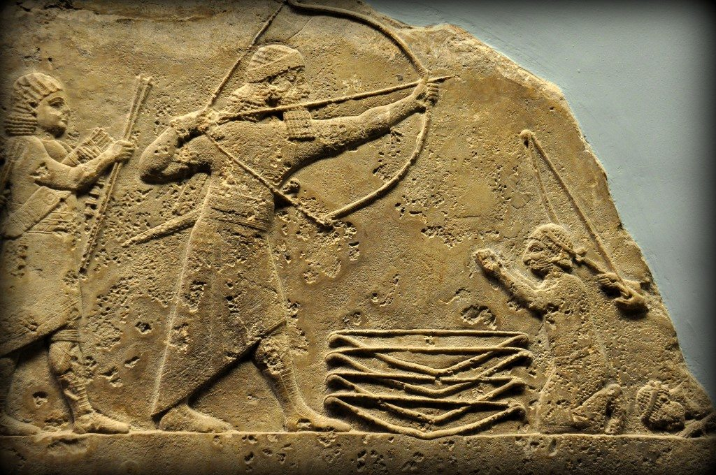 Alabaster bas-relief showing Ashurbanipal rescuing foreign princes from a lion. Those princes, the men on the right of the panel, are kneeling and throwing their bows before the king; the came to the Assyrian capital as political refugees. Ashurbanipal took them off to shoot lions, but they have missed, and he is shooting over their heads. There will have been a charging lion on the lost panel to the right. From Room S of the North Palace, Nineveh (modern-day Kouyunjik, Mosul Governorate), Mesopotamia, Iraq. Circa 645-535 BCE. The British Museum, London. Photo©Osama S.M. Amin.