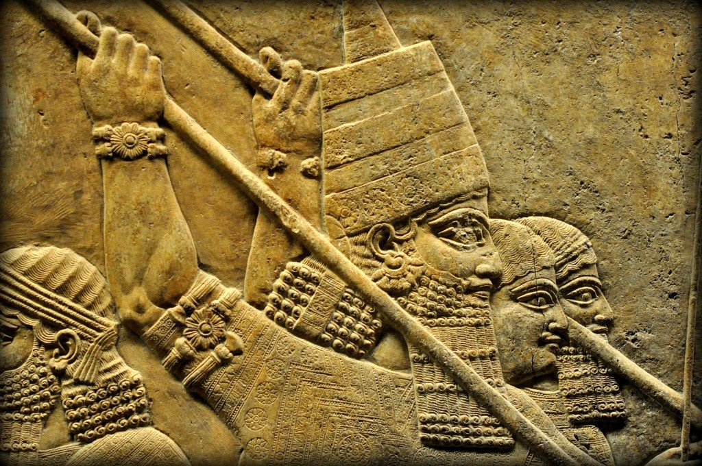 Assyrian Lion. Detail of an alabaster-bas relief depicting the Assyrian king Ashurbanipal. The king is identified by his conical head cap. He holds a long spear and stabs a leaping lion in his head. Note the exquisitely carved embroidery, armlets, earring, and costume. Two royal attendants ward off the lion with their spear. One of his royal attendants is guiding the royal chariot. From Room C of the North Palace, Nineveh (modern-day Kouyunjik, Mosul Governorate), Mesopotamia, Iraq. Circa 645-535 BCE. The British Museum, London. Photo©Osama S.M. Amin.