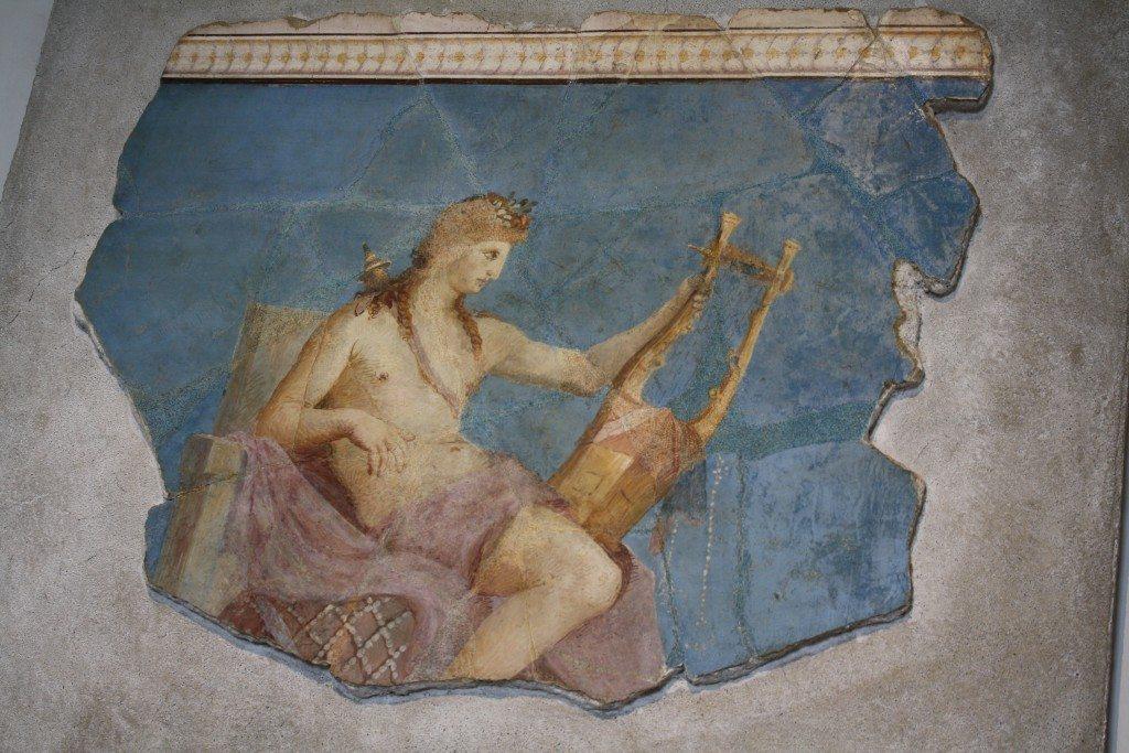 1st century CE Roman fresco of Apollo playing the kithara. (Museum of the Forum Romanum, Rome)