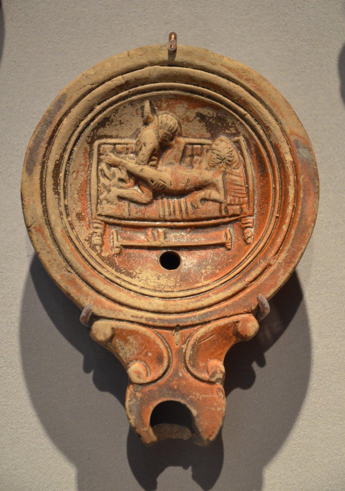 Roman oil lamp: erotic images