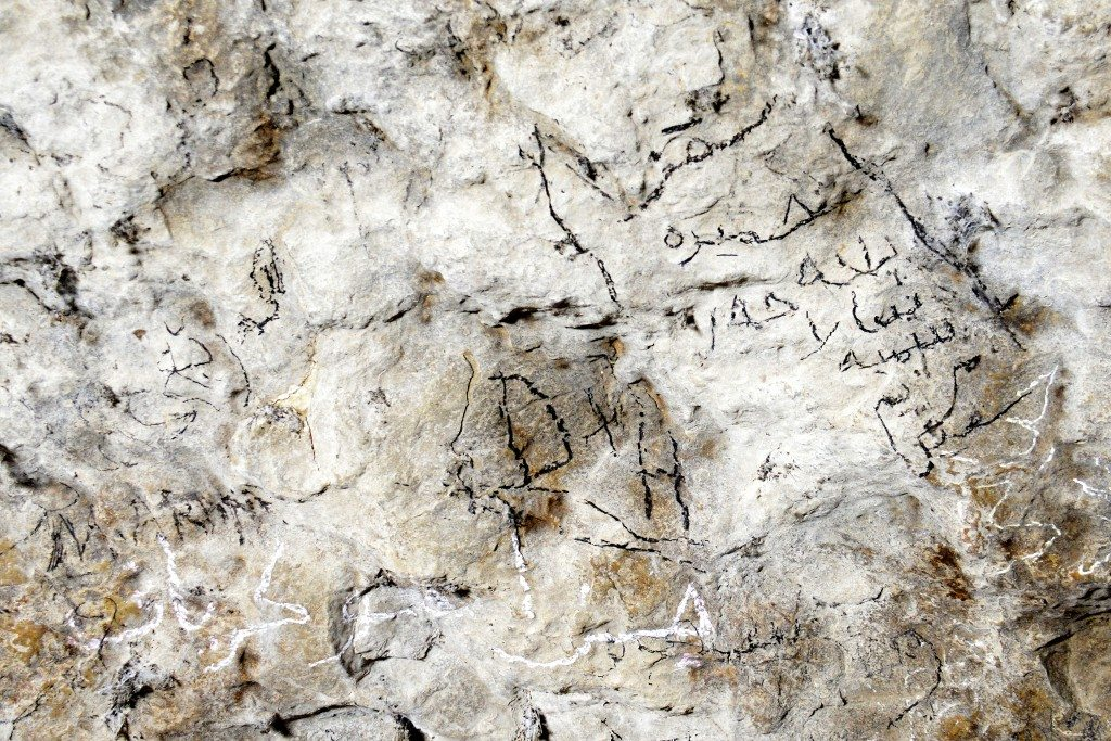 Visitors have left their memories by writing their names (in Kurdish and English letters) on the walls of one of the caves, Ashkawty Tarik. Photo © Osama S. M. Amin.