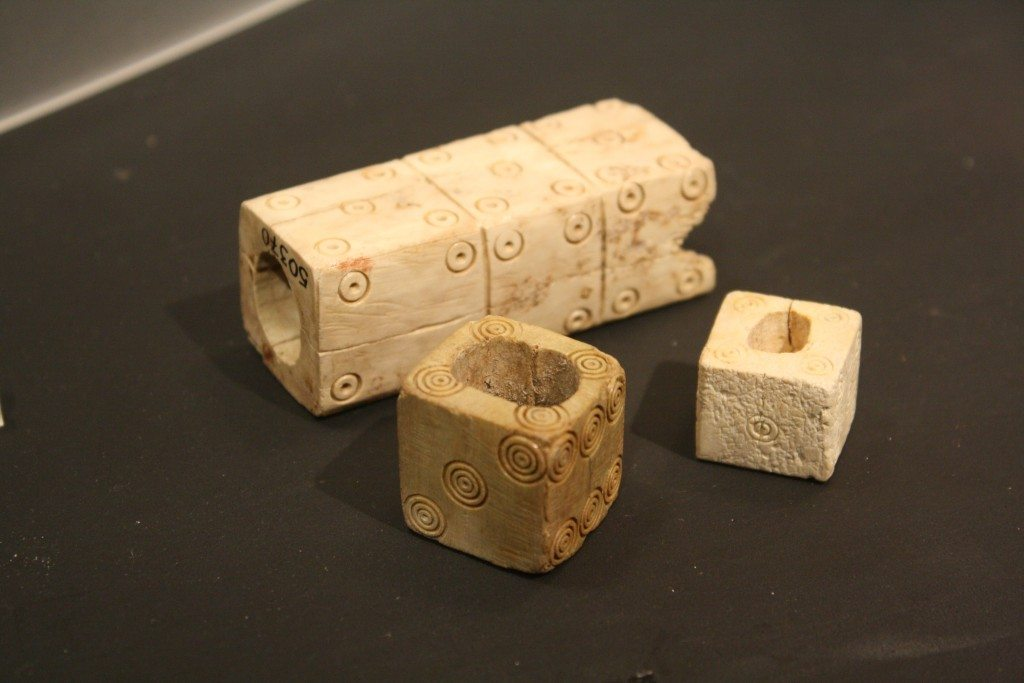 Roman dice in bone and ivory. The larger, triple dice is an unfinshed work. Roman Imperial period. (Palazzo Massimo, Rome)