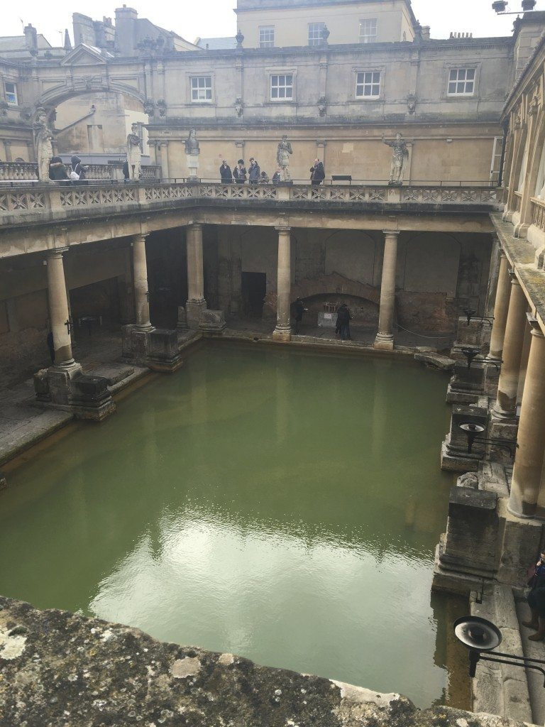 Mist rises from the water in the Great Bath at the Roman baths. Image © Caroline Cervera.
