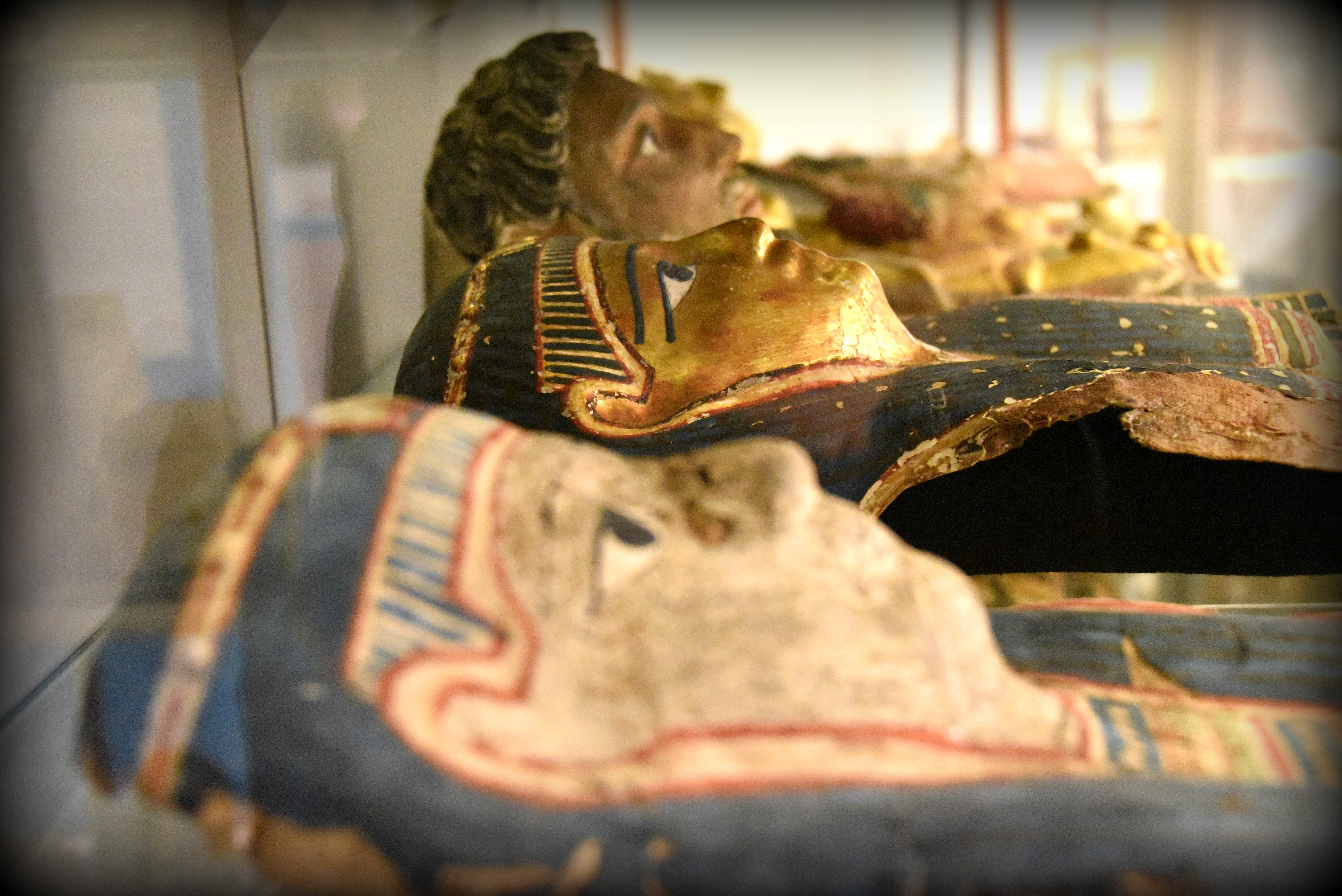 Cartonnage mummy masks. Wealthier ancient Egyptians were keen to prepare for the afterlife. A mummy case was important part for the funerary equipment. After the body was embalmed and wrapped, in a linen bandage, the mummy was placed in case of coffin. Egyptians of a high social status often had lavish and colorful cases.  With thanks to the Petrie Museum of Egyptian Archaeology. Photo © Osama S. M. Amin.