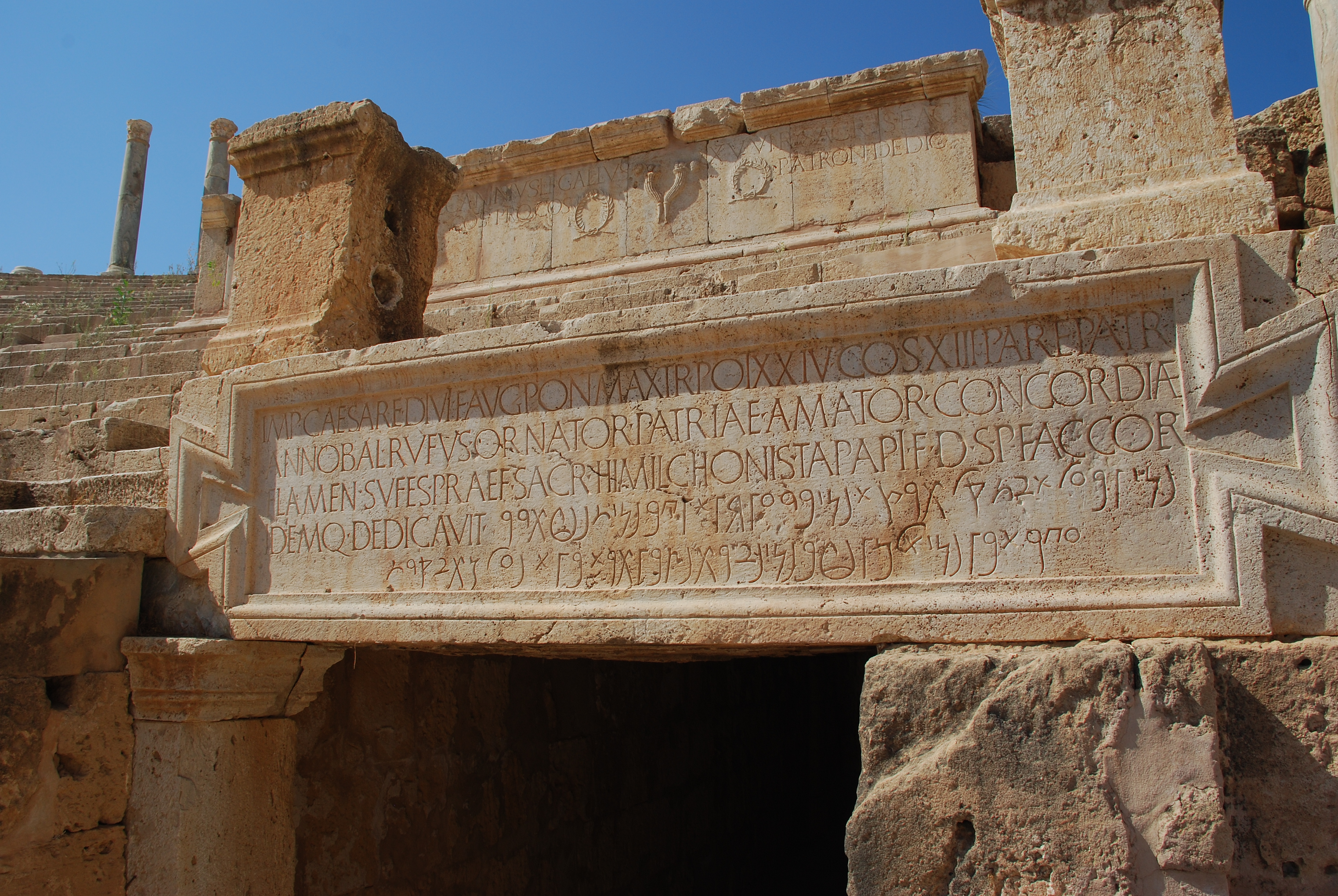 Inscription Theatre Leptis Magna Libya. By Papageizichta. https://upload.wikimedia.org/wikipedia/commons/2/2c/Inscription_Theatre_Leptis_Magna_Libya.JPG