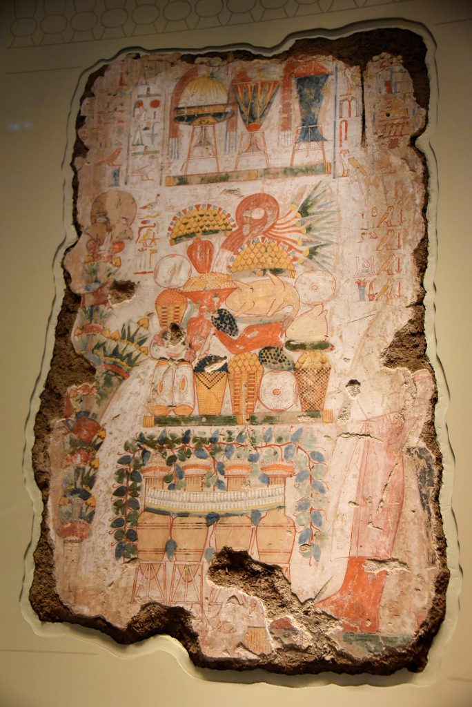 This was the most important scene in the tomb-chapel. It is painted in a formal style with white rather than cream backgorund to make it stand put. It shows a huge pile of lavish fodd before the dead Nebamun and his wife (now lost), with wine and ornate perfume jars. Their son, Netjermes (now lost) offers them a tall banquet of papyrus and flowers, symbolic of the annual vestival of the god Amun, when relatives came to visit the dead. The hierglyphic capttion contains funerary prayers and a list of offerings. The British Museum, London. Photo © Osama S. M. Amin. Photo © Osama S. M. Amin.