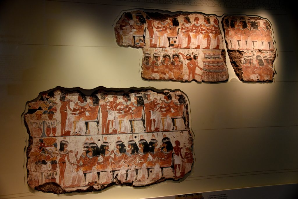 An entire wall of the tomb-chapel shows a feast in honor of Nebamun. Naked serving girls and servants wait on his friends and relatives. Married guests sit in pairs on fine chairs, while the young women turn and talk to each other. This erotic scene of relaxation and wealth is something for Nebamun to enjoy for all eternity. The richly dressed guests are entertained by dancers and musicians, who sit on the ground playing and clapping. The words of their song in honor of Nebamun are wirtten above them: The earth God has caused his beauty to grow in every body...the channels are filled with water anew, and the land is flooded with love of him. The British Museum, London. Photo © Osama S. M. Amin. Photo © Osama S. M. Amin.