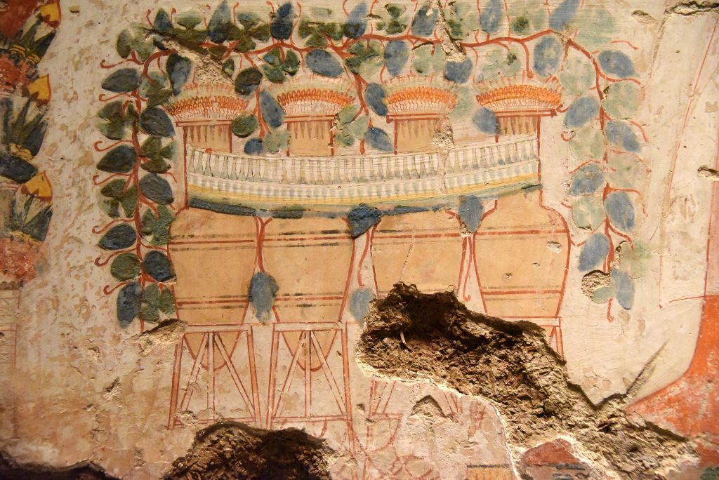 Large jars of wine are garlanded with grapes and vines. In many places the green and blue has been lost, since these colors were pallied as roughly ground pigments which fallen away. The British Museum, London. Photo © Osama S. M. Amin. Nebamun tomb-chapel.