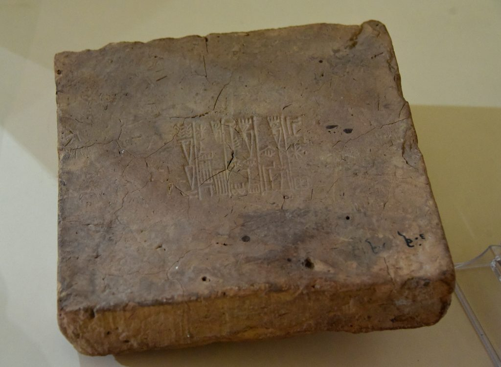 "Mud-brick inscribed with the name of the Neo-Sumerian king Ur-nammu, reigned 2047-2030 BCE. From southern Mesopotamian, modern-day Iraq; precise provenance of excavation is unknown. Ur III period. Erbil Civilization Museum, Iraqi Kurdistan. NB: note the Arabic word ""نفر"" on the right lower corner, written by a marker pen. It means ""Nippur."" Nippur is one of the ancient Sumerian cities in southern Mesopotamia. The brick might well have been found there?! Photo © Osama S. M. Amin."