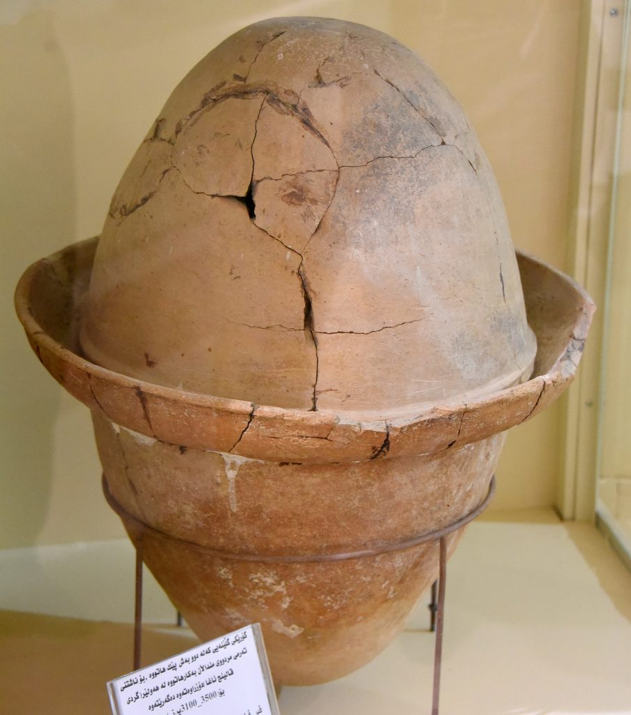 Pottery tomb in the shape of an egg. Such tombs were used for deceased children burials. From Tell Qaling Agha, Erbil City, Iraqi Kurdistan. Circa 3500-3100 BCE. Erbil Civilization Museum, Iraqi Kurdistan. Photo © Osama S. M. Amin.