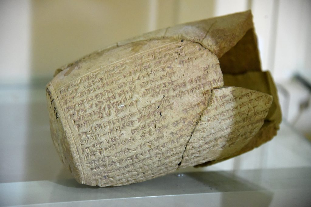 "Clay hollow cylinder inscribed with cuneiform texts. From Mesopotamia, modern-day Iraq; precise provenance of excavation is unknown. Neo-Assyrian period, 911-612 BCE. Erbil Civilization Museum, Iraqi Kurdistan. NB: ""ND 7100"" can be recognized on the cylinder's intact left bottom. I surfed the net and found that this is ""Easarhaddon cylinder fragments from fort Shalmaneser, Nimrud"". It was found in the city of Nimrud and was housed in the Iraqi Museum, Baghdad. Please see http://www.jstor.org/stable/4199705?seq=1#page_scan_tab_contents . If you find any ancient artifact marked with the letters ""ND and a number"", it means that these were excavated at the city of Nimrud (ancient Kalhu; Biblical Calah). Exclusive photo, never-before-published. Photo © Osama S. M. Amin."
