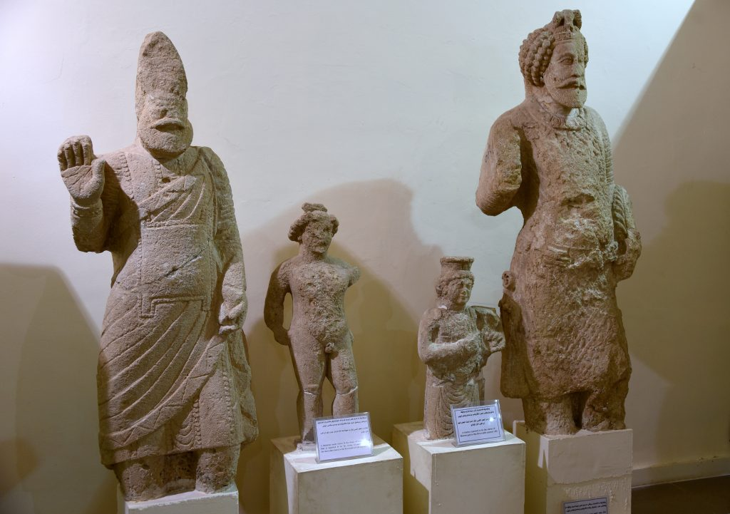 From left to right: Life-size statue of an unknown leader/ruler from Hatra; a small statue depicting an unidentified deity but it might well represent the messenger god Hermes; small statue of an unidentified female deity; life-size statue of king Sanatruq I. From Hatra, modern-day Mosul Governorate, Iraq. 1st century CE. Erbil Civilization Museum, Iraqi Kurdistan. Photo © Osama S. M. Amin.