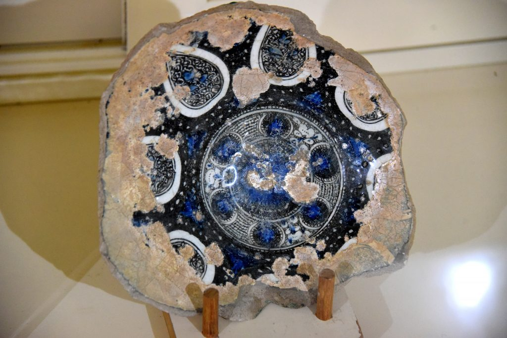 A partially survived glazed glass plate. From modern-day Iraq; precise provenance of excavation is unknown. Abbasid period, 750-1258 CE. Erbil Civilization Museum, Iraqi Kurdistan. Photo © Osama S. M. Amin.